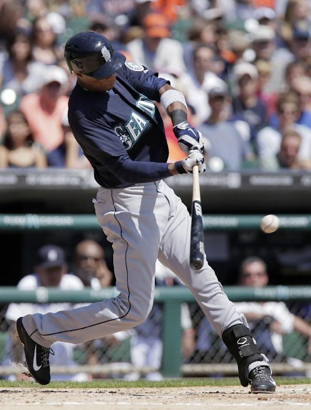 Seattle Mariners' Austin Jackson singles against the Detroit Tigers during the second inning of a baseball game on Sunday, Aug. 17, 2014, in Detroit. (AP Photo/Duane Burleson)