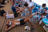 Feet first: after each stage the podiatrists are busy treating the torn and blistered feet (AFP/JEAN-PHILIPPE KSIAZEK)