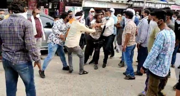 A mob led by local Congress leaders and workers assaulting journalist Kamal Shukla in Kanker district of Chhattisgarh on September 26