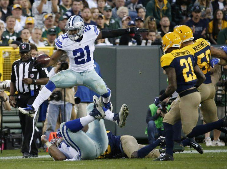 Ezekiel Elliott needs to average 110.6 yards per game for the rest of the year to break Eric Dickerson's single-season record of 1,808 rushing yards. (AP)