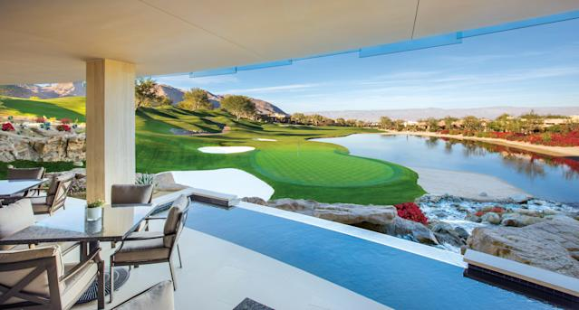 """<h1 class=""""title"""">Bighorn Golf Club clubhouse view of 18th.jpg</h1> <div class=""""caption""""> Here's the view looking out from the back of the clubhouse—complete with a horizon waterfall. </div> <cite class=""""credit"""">Mark Davidson</cite>"""