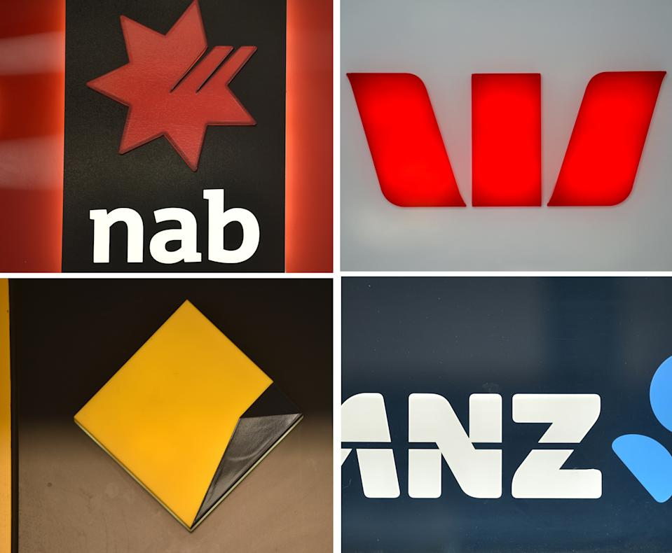 """This combination of photos taken in Sydney on November 30, 2017 show the signs of the """"big four"""" Australian banks (clockwise from top L) National Australia Bank (NAB, Westpac, ANZ and Commonwealth Bank. A wide-ranging inquiry into the Australian finance industry will be held after an admission by the country's top lenders on November 30 that it was needed to restore faith in the massively profitable banking sector after a string of scandals. / AFP PHOTO / PETER PARKS        (Photo credit should read PETER PARKS/AFP via Getty Images)"""