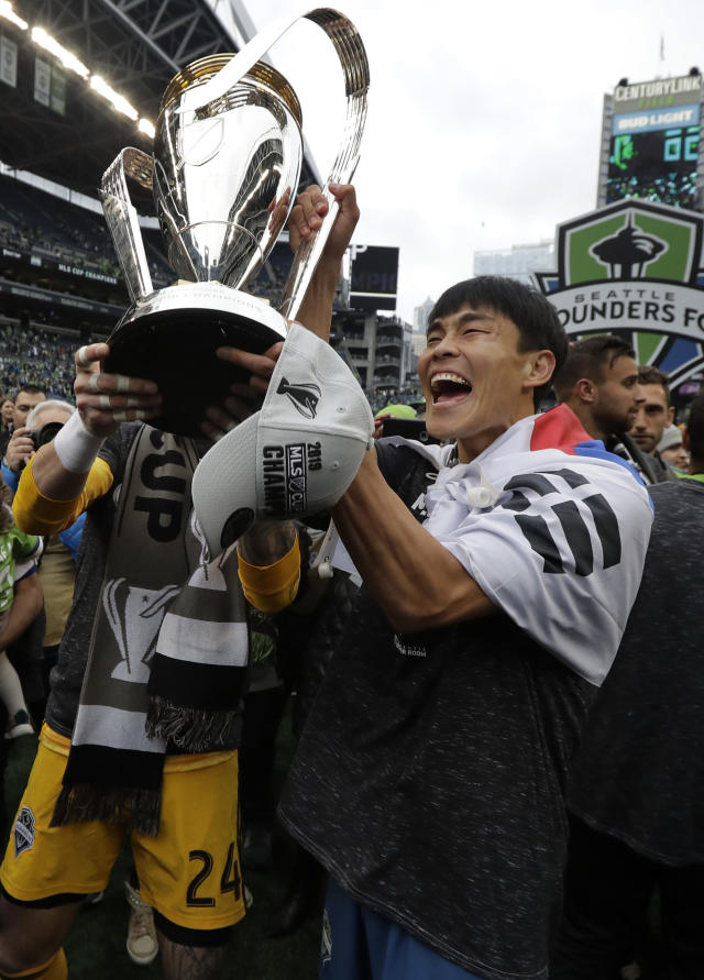 Seattle Sounders' Kim Kee-hee celebrates, Sunday, Nov. 10, 2019, after defeating Toronto FC in the MLS Cup championship soccer match in Seattle. The Sounders won 3-1. (AP Photo/Ted S. Warren)