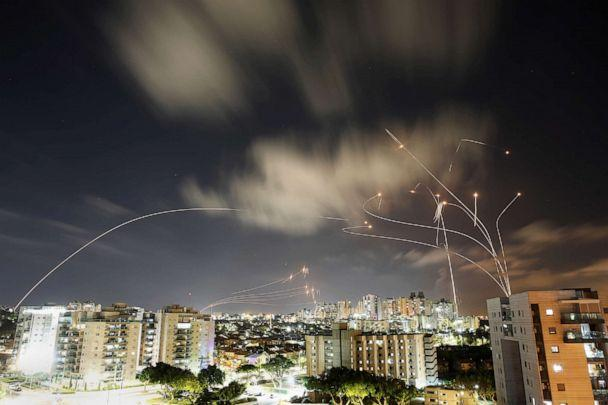 PHOTO: Streaks of light are seen as Israel's Iron Dome anti-missile system intercepts rockets launched from the Gaza Strip towards Israel, as seen from Ashkelon, Israel, May 12, 2021. (Amir Cohen/Reuters)