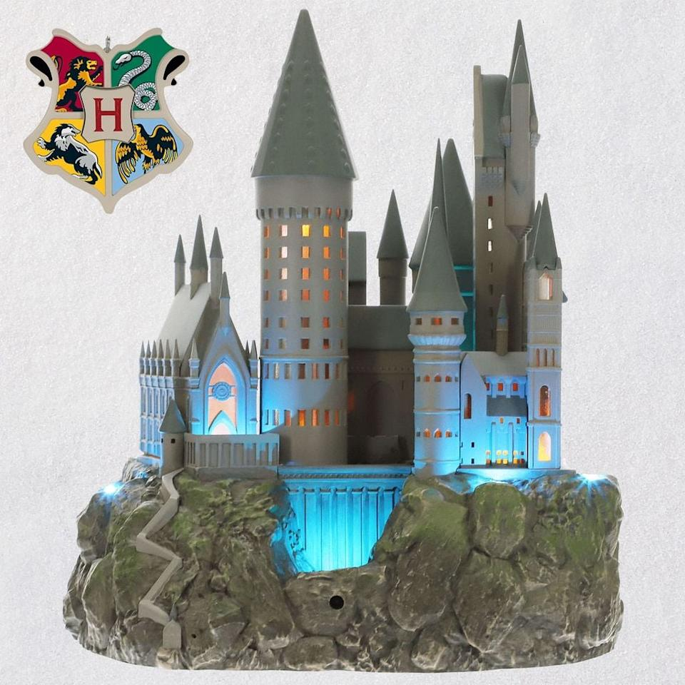 "<p><a href=""https://www.popsugar.com/buy/Hallmark-Harry-Potter-Hogwarts-Castle-Musical-Tree-Topper-Light-471961?p_name=Hallmark%27s%20Harry%20Potter%20Hogwarts%20Castle%20Musical%20Tree%20Topper%20With%20Light&retailer=hallmark.com&pid=471961&price=120&evar1=casa%3Aus&evar9=46417245&evar98=https%3A%2F%2Fwww.popsugar.com%2Fphoto-gallery%2F46417245%2Fimage%2F46417248%2FHallmark-Harry-Potter-Hogwarts-Castle-Musical-Tree-Topper-Light&list1=holiday%2Cchristmas%2Cchristmas%20decorations%2Charry%20potter%2Cchristmas%20ornaments%2Choliday%20decor%2Cchristmas%20decor&prop13=api&pdata=1"" rel=""nofollow"" data-shoppable-link=""1"" target=""_blank"" class=""ga-track"" data-ga-category=""Related"" data-ga-label=""https://www.hallmark.com/ornaments/keepsake-ornaments/harry-potter-collection-hogwarts-castle-musical-tree-topper-with-light-1QXI3277.html"" data-ga-action=""In-Line Links"">Hallmark's Harry Potter Hogwarts Castle Musical Tree Topper With Light</a> ($120)</p>"