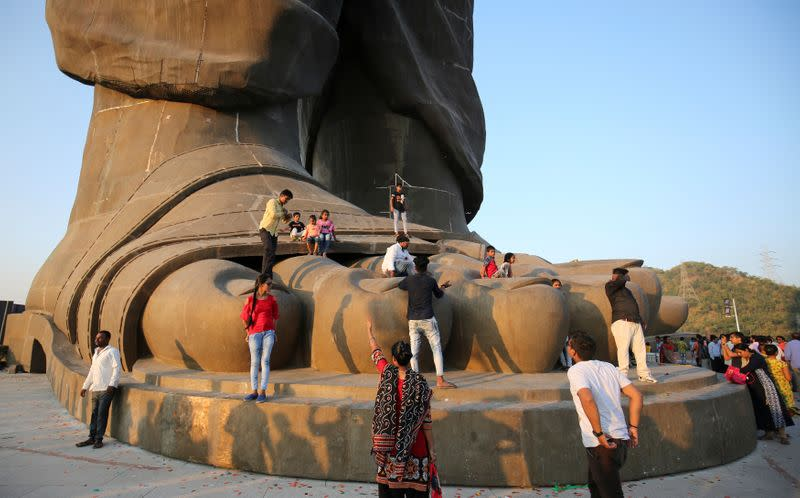 """People visit the """"Statue of Unity"""" portraying Sardar Vallabhbhai Patel, one of the founding fathers of India, during its inauguration in Kevadia"""