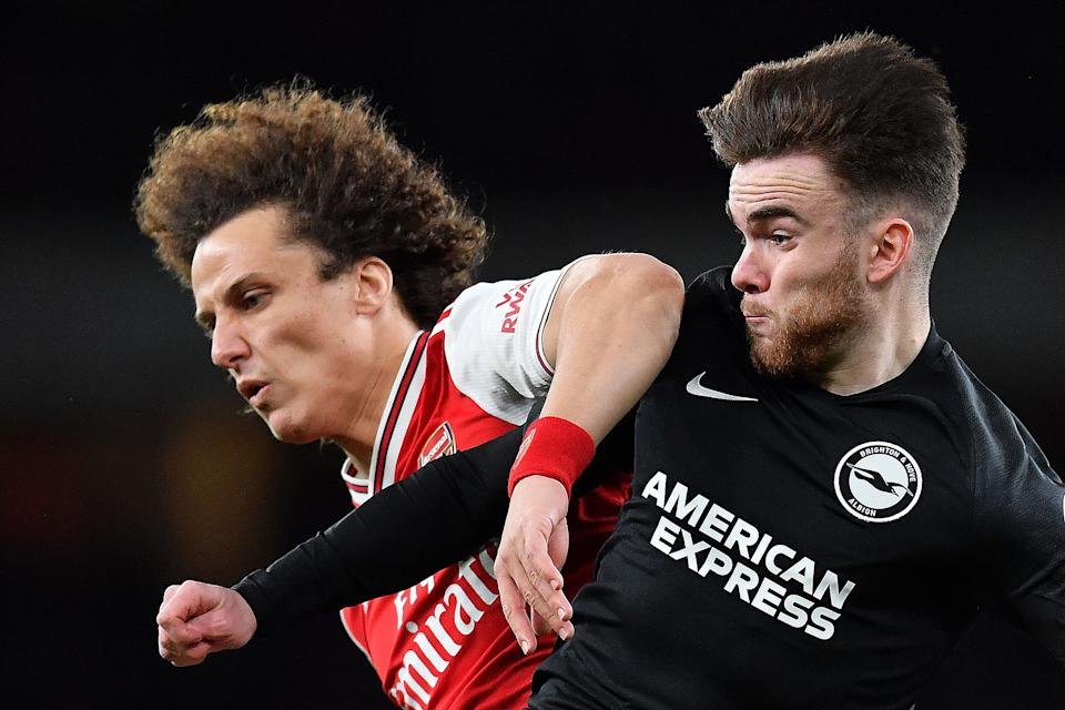 Arsenal's Brazilian defender David Luiz (L) vies with Brighton's Irish striker Aaron Connolly during the English Premier League football match between Arsenal and Brighton and Hove Albion at the Emirates Stadium in London on December 5, 2019. (Photo by Ben STANSALL / AFP) / RESTRICTED TO EDITORIAL USE. No use with unauthorized audio, video, data, fixture lists, club/league logos or 'live' services. Online in-match use limited to 120 images. An additional 40 images may be used in extra time. No video emulation. Social media in-match use limited to 120 images. An additional 40 images may be used in extra time. No use in betting publications, games or single club/league/player publications. /  (Photo by BEN STANSALL/AFP via Getty Images)