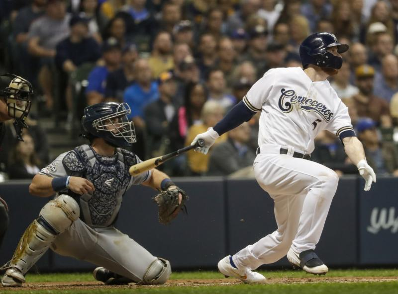 Milwaukee Brewers' Cory Spangenberg hits a two-run scoring triple during the fourth inning of a baseball game against the San Diego Padres Monday, Sept. 16, 2019, in Milwaukee. (AP Photo/Morry Gash)
