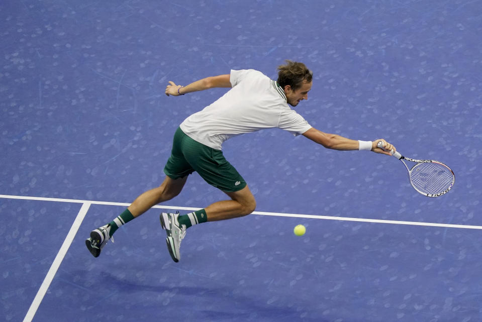 Daniil Medvedev, of Russia, returns a shot to Dominik Koepfer, of Germany, during the second round of the US Open tennis championships, Wednesday, Sept. 1, 2021, in New York. (AP Photo/Seth Wenig)