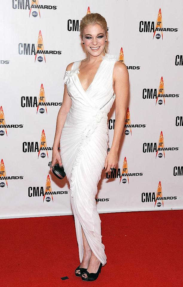 """LeAnn Rimes  Grade: D  Eddie Cibrian's latest love vamped it up in a heavenly white dress, which was unfortunately overshadowed by her goth-inspired eye makeup and fingernail polish. Frederick Breedon/<a href=""""http://www.gettyimages.com/"""" target=""""new"""">GettyImages.com</a> - November 11, 2009"""