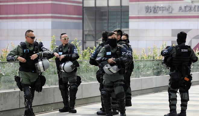 Special police from the Correctional Services Department patrol in Central. Photo: Xiaomei Chen