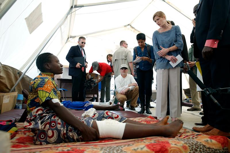 US ambassador to the United Nations Samantha Power, right, listens to Lucy Mandazuto at Bangui's community hospital in Bangui, Central African republic, Thursday, Dec. 19, 2013. Mandazuto was wounded in sectarian violence. Power is on a day-long visit to the war struck country. (AP Photo/Jerome Delay)