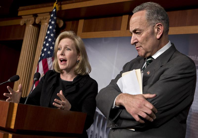 Sen. Kirsten Gillibrand, D-N.Y., left, and Sen. Charles Schumer, D-N.Y., right, react after the Senate passed a $50.5 billion emergency relief measure for Superstorm Sandy victims at the Capitol in Washington, Monday, Jan. 28, 2013. Three months after Superstorm Sandy devastated coastal areas in much of the Northeast, the Senate is finaly sending a $50.5 billion emergency package of relief and recovery aid to President Obama for his signature. (AP Photo/J. Scott Applewhite)