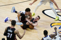 Miami Heat forward Duncan Robinson, right, and Dallas Mavericks guard Josh Green (8) battle for a loose ball during the first half of an NBA basketball game, Tuesday, May 4, 2021, in Miami. (AP Photo/Wilfredo Lee)