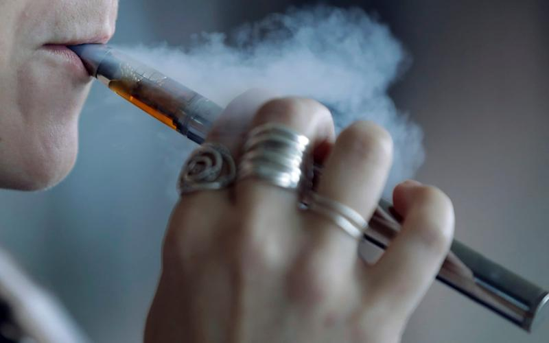 Smoking is thought to increase the risk of coronavirus infection as your hand is often close to - or touching - your face - Tony Dejak/AP