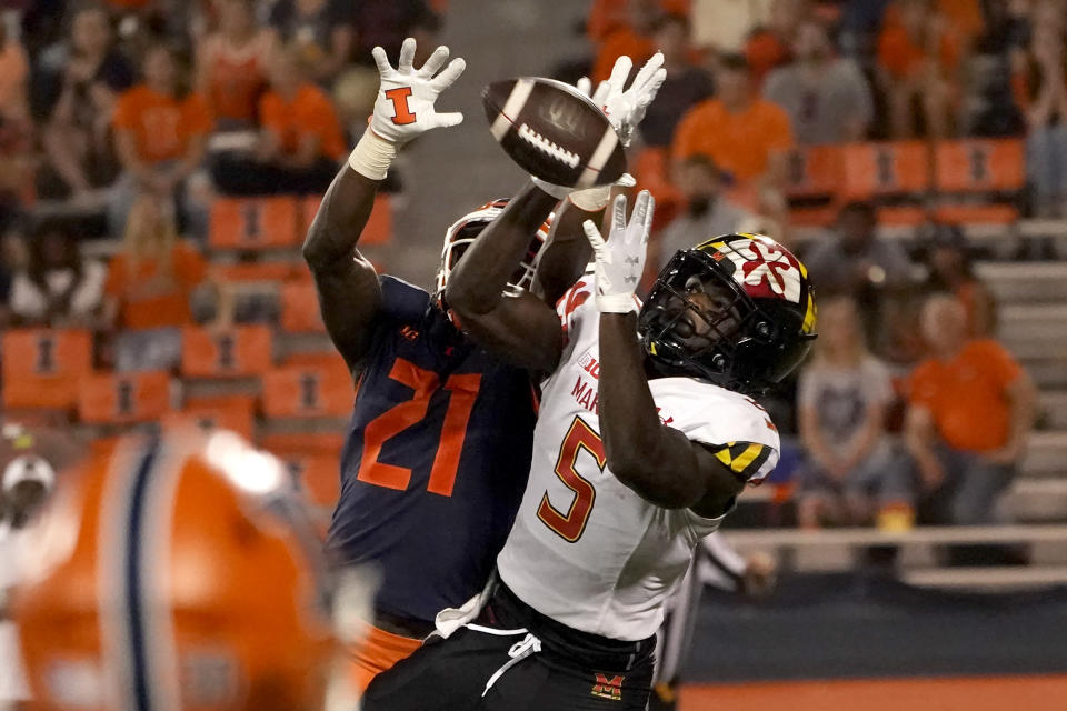 Illinois defensive back Jartavius Martin (21) breaks up a pass intended for Maryland wide receiver Rakim Jarrett during the second half of an NCAA college football game Friday, Sept. 17, 2021, in Champaign, Ill. Maryland won 20-17. (AP Photo/Charles Rex Arbogast)