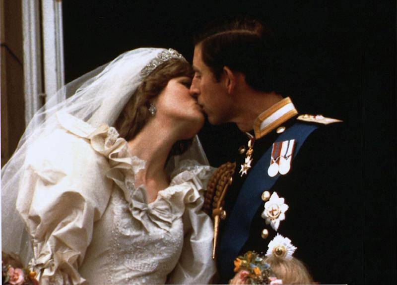 FILE PHOTO 29JUL81- Prince Charles kisses his new bride Diana on their wedding day July 29, 1981. Diana and her millionaire companion Dodi Al Fayed were killed early Sunday when their car crashed in a Paris tunnel underpass. FRANCE DIANA