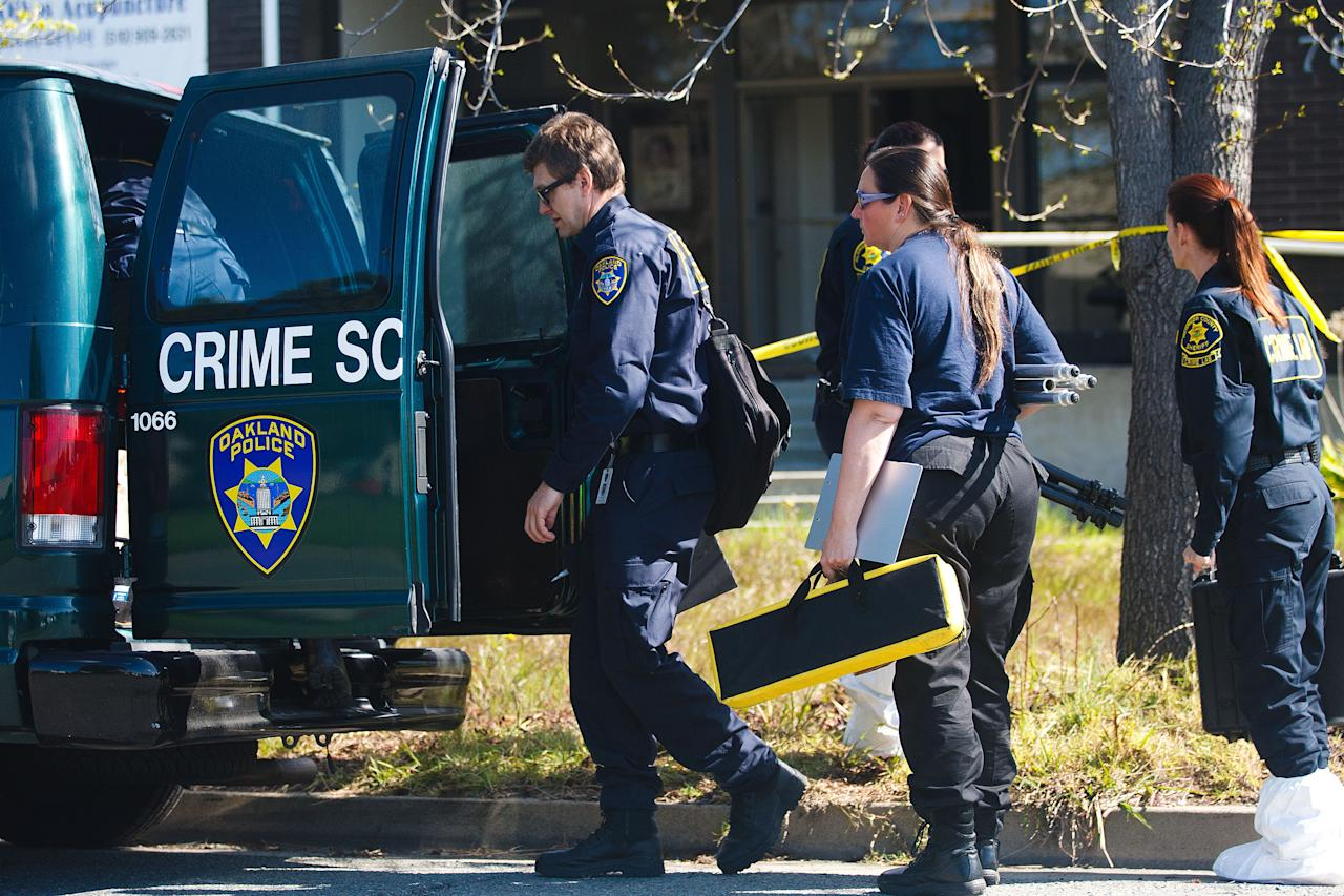 Members of the Oakland Police Crime Scene Investigation Unit prepare to enter Oikos University where a gunman had gone on a shooting rampage, April 4, 2012 in Oakland, California. Six students and one employee were killed on Monday when a gunman opened fire at Christian-based Oikos University. The suspect One Goh, a former nursing student at the school, was arrested shortly after the shooting and is expected to make his first court appearance.  (Photo by Jonathan Gibby/Getty Images)