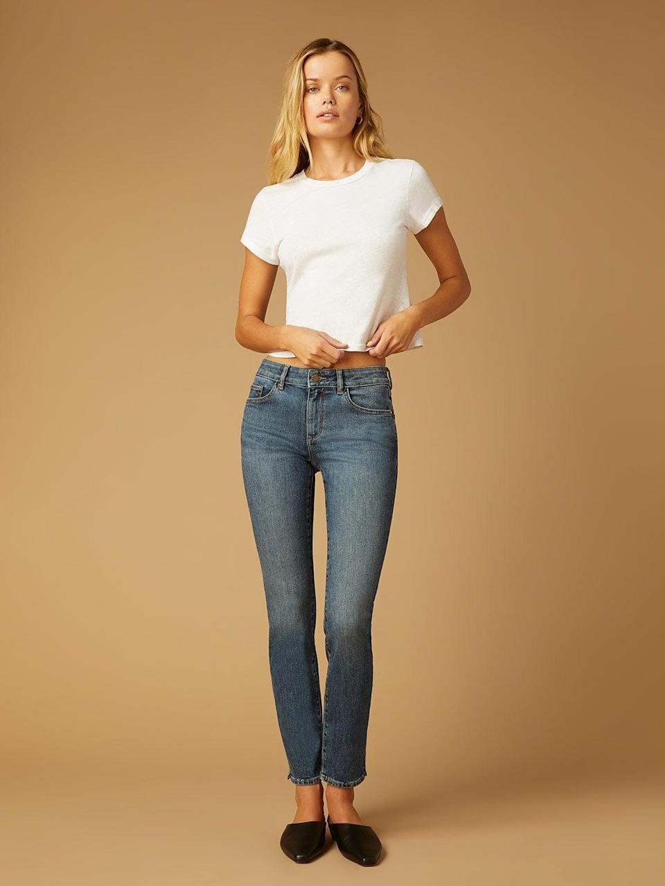 <p><span>DL1961's Angel Cigarette Mid-Rise Instasculpt</span> ($179) jean maintains its shape with a contoured waistband and high-retention fit to sculpt your legs, butt, and waist. </p>