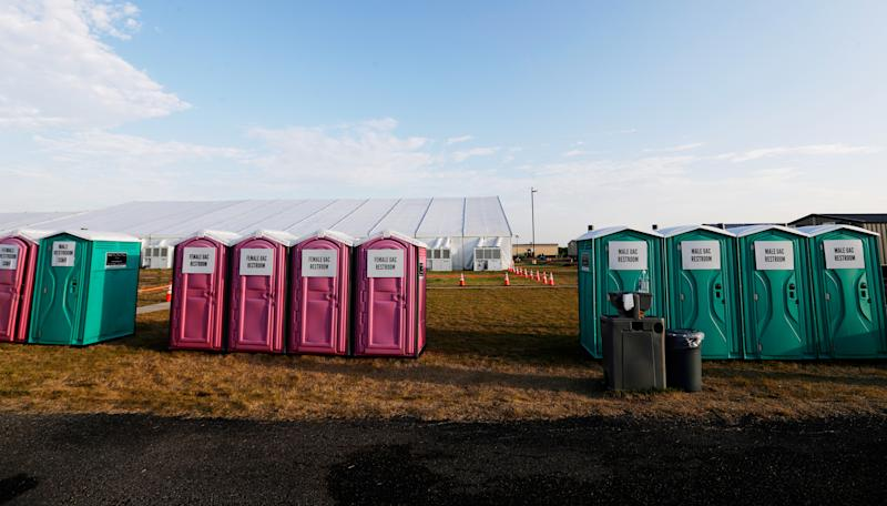 Portable restrooms are lined up along a soccer field at the U.S. government's newest holding center for migrant children in Carrizo Springs, Texas. (Photo: Eric Gay/Pool via Reuters)