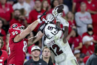 South Carolina defensive back Jaylan Foster (12) intercepts a pass intended for Georgia tight end John FitzPatrick (86) during the second half of an NCAA college football game Saturday, Sept. 18, 2021, in Athens, Ga. Georgia won 40-13. (AP Photo/Butch Dill)
