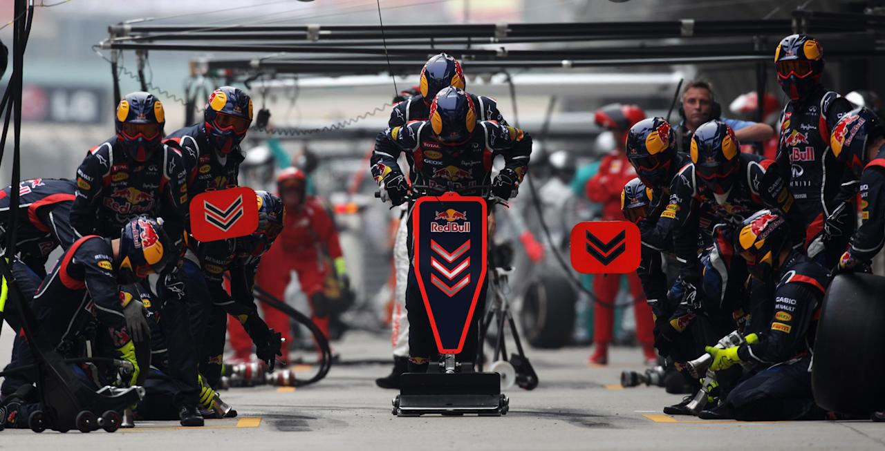 SHANGHAI, CHINA - APRIL 15:  Red Bull Racing team wait for one of their drivers in the pitlane during the Chinese Formula One Grand Prix at the Shanghai International Circuit on April 15, 2012 in Shanghai, China.  (Photo by Mark Thompson/Getty Images)