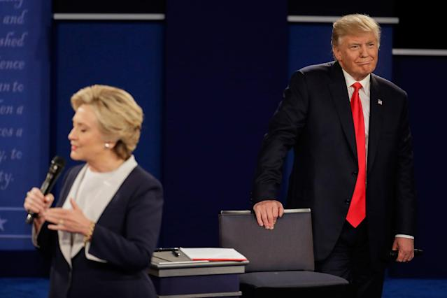 <p>Republican presidential nominee Donald Trump listens as Democratic presidential nominee Hillary Clinton answers a question during the second presidential debate at Washington University in St. Louis, Mo., Sunday, Oct. 9, 2016. (Photo: Julio Cortez/AP) </p>
