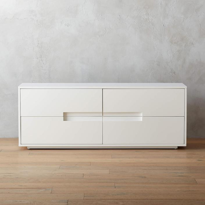 """The Latitude dresser is the furniture equivalent of the phrase """"the simplest solution is almost always the best."""" Low and lean, MASHstudios' exclusive modern design for CB2 boasts a high-gloss white finish that adds undeniable brightness to just about any space. $599, CB2. <a href=""""https://www.cb2.com/latitude-white-low-dresser/s688361"""" rel=""""nofollow noopener"""" target=""""_blank"""" data-ylk=""""slk:Get it now!"""" class=""""link rapid-noclick-resp"""">Get it now!</a>"""