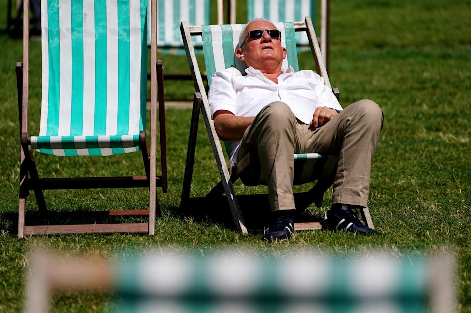 A sunbather lounges on a deck chair in Green Park, London (Jonathan Brady/PA) (PA Wire)