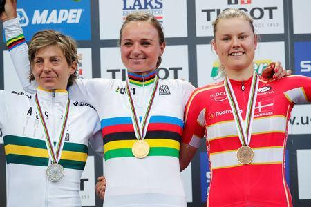 World Champion and gold medalist Chantal Blaak (C) of The Netherlands flanked by silver medalist Katrin Garfoot (L) of Australia and bronze medalist Amalie Dideriksen (R) of Denmark on the podium after UCI Cycling Road World Championships Women Elite Road Race in Bergen, Norway September 23, 2017. NTB scanpix/Cornelius Poppe/via REUTERS