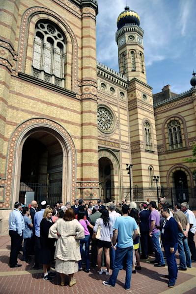Participants of the World Jewish Congress listen to the guide in front of the Dohany Street Synagogue in Budapest, Hungary, Saturday, May 4, 2013, one day ahead of the opening of the congress. (AP Photo/MTI, Laszlo Beliczay)
