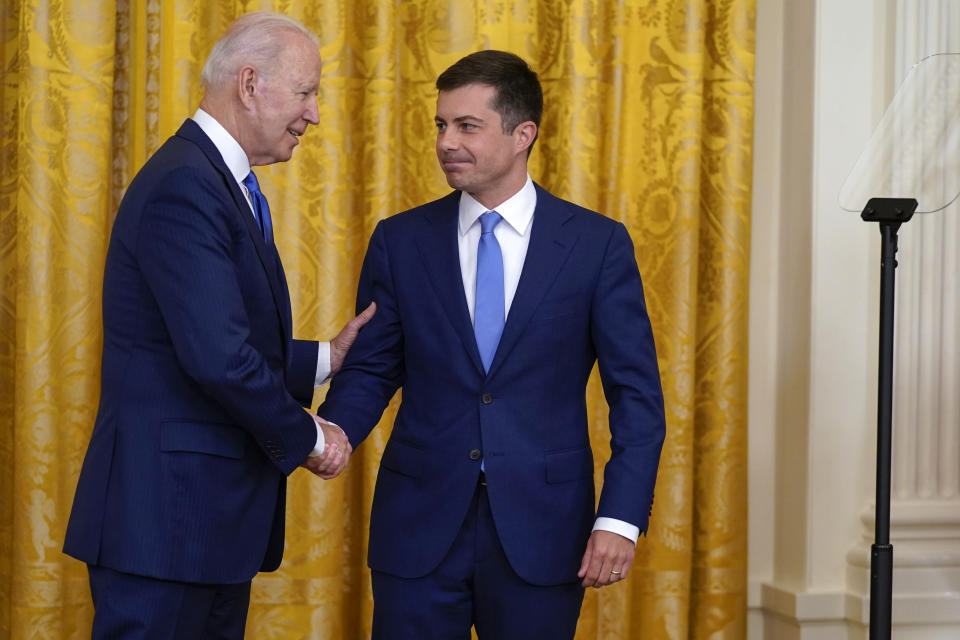 President Joe Biden shakes hands with Transportation Secretary Pete Buttigieg during an event to commemorate Pride Month, in the East Room of the White House, Friday, June 25, 2021, in Washington. (AP Photo/Evan Vucci)