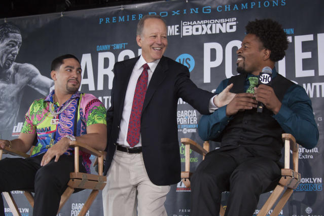 Jim Gray (C), shown here between Danny Garcia and Shawn Porter at a July 2018 news conference, is an integral part of Showtime's boxing broadcasts. (Getty Images)
