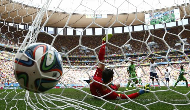 France's goalkeeper Hugo Lloris fails to stop a goal shot by Nigeria's Emmanuel Emenike, which was later disallowed, during their 2014 World Cup round of 16 game at the Brasilia national stadium in Brasilia June 30, 2014. REUTERS/Jorge Silva (BRAZIL - Tags: SOCCER SPORT WORLD CUP)
