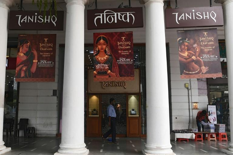 A man walks past a Tanishq jewellery showroom in New Delhi. The company has withdrawn an advert featuring an interfaith baby shower after a backlash by Hindu conservatives