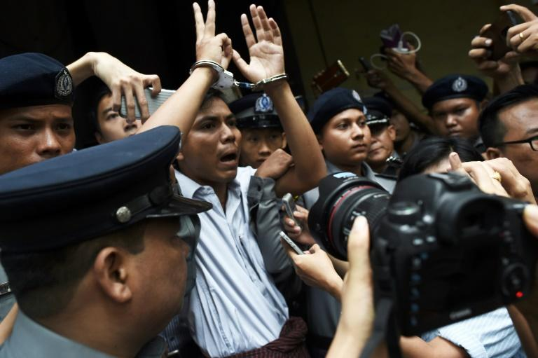 Kyaw Soe Oo, seen here after being sentenced, was charged with violating the Official Secrets Act with his colleague Wa Lone