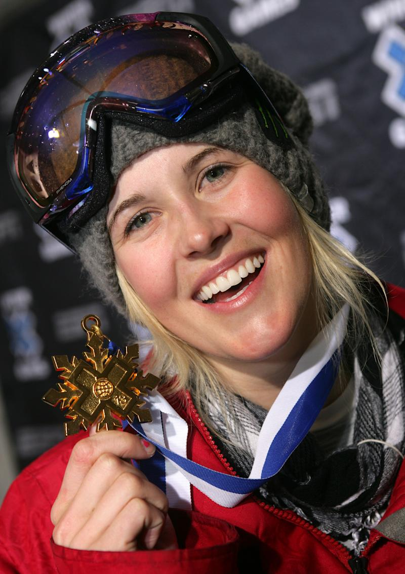 FILe - In this Jan. 23, 2009 file photo, Sarah Burke, of Canada, holds her gold metal after winning the Women's Superpipe event at Winter X Games 13 at Buttermilk Ski Area, near Aspen, Colo. Burke remains in a coma, a day after she was airlifted from the mountains of Utah to a Salt Lake City hospital with serious injuries after a training accident in the superpipe. Peter Judge, CEO of the Canadian freestyle team, says Burke's family is at the hospital, and an update on Burke's condition is expected later Wednesday, Jan. 11, 2012.  (AP Photo/Nathan Bilow, File)