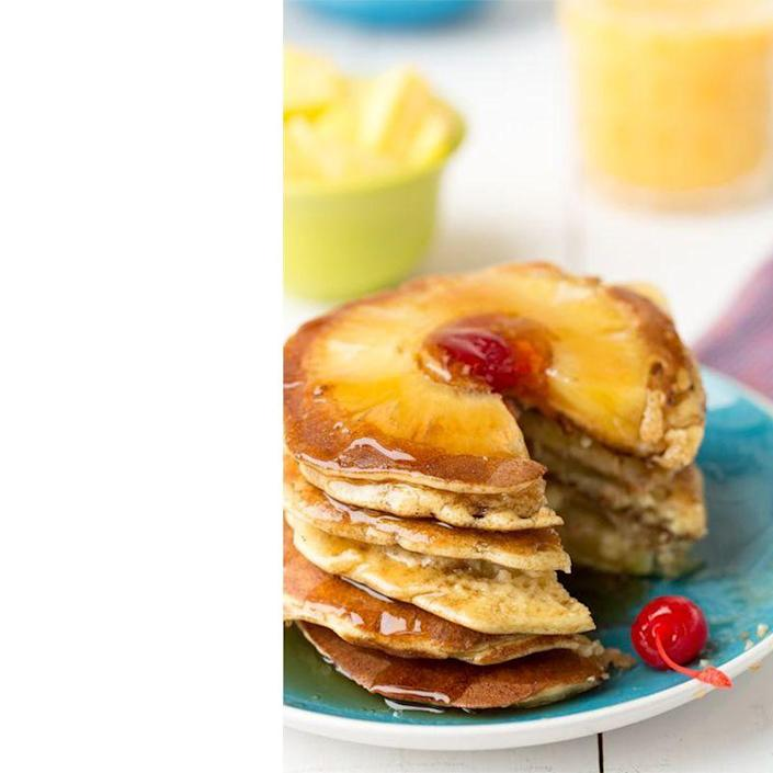 """<p>Take dad's favorite dessert and make it his Father's Day breakfast. Pro-tip: wait until the pancakes are almost ready to flip before adding the pineapple ring for a cleaner outcome.</p><p><em>Get the recipe from <a href=""""https://www.delish.com/cooking/recipes/a47058/pineapple-upside-down-pancakes-recipe/"""" rel=""""nofollow noopener"""" target=""""_blank"""" data-ylk=""""slk:Delish."""" class=""""link rapid-noclick-resp"""">Delish.</a></em></p>"""