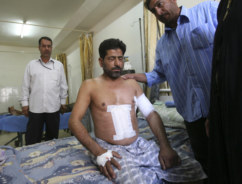 FILE -In this Sept. 20, 2007, file photo Hassan Jabir, 37, recovers from gunshot wounds in a hospital in Baghdad, Iraq, received in his car in the Mansour neighborhood when guards in a U.S. State Department convoy opened fire, shooting him four times. The U.S. Justice Department has brought fresh charges against former Blackwater Worldwide security contractors over a deadly 2007 shooting on the streets of Baghdad. The jury indictment announced Thursday, Oct. 17, 2013 charges four men with voluntary manslaughter and other crimes. The case stems from the shooting of 17 Iraqi civilians. Blackwater security contractors were guarding U.S. diplomats when they opened fire at an intersection. Their lawyers have said the insurgents ambushed the guards. (AP Photo/ Khalid Mohammed/File)