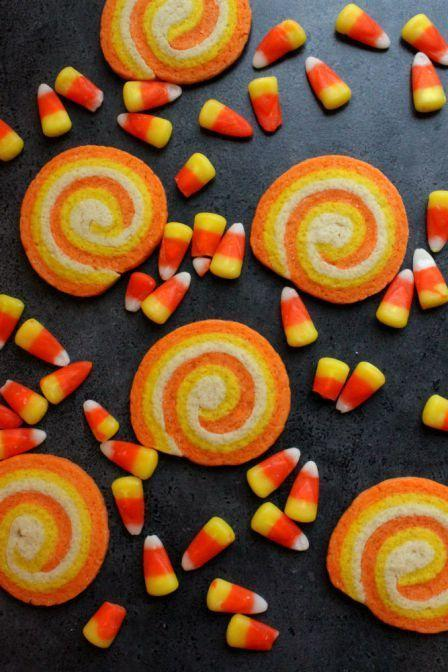 "<p>Serve with actual candy corn for the best effect.</p><p>Get the recipe from <a href=""https://thesimplesweetlife.wordpress.com/2013/10/05/candy-corn-swirl-cookies/"" rel=""nofollow noopener"" target=""_blank"" data-ylk=""slk:The Simple Sweet Life"" class=""link rapid-noclick-resp"">The Simple Sweet Life</a>.</p>"
