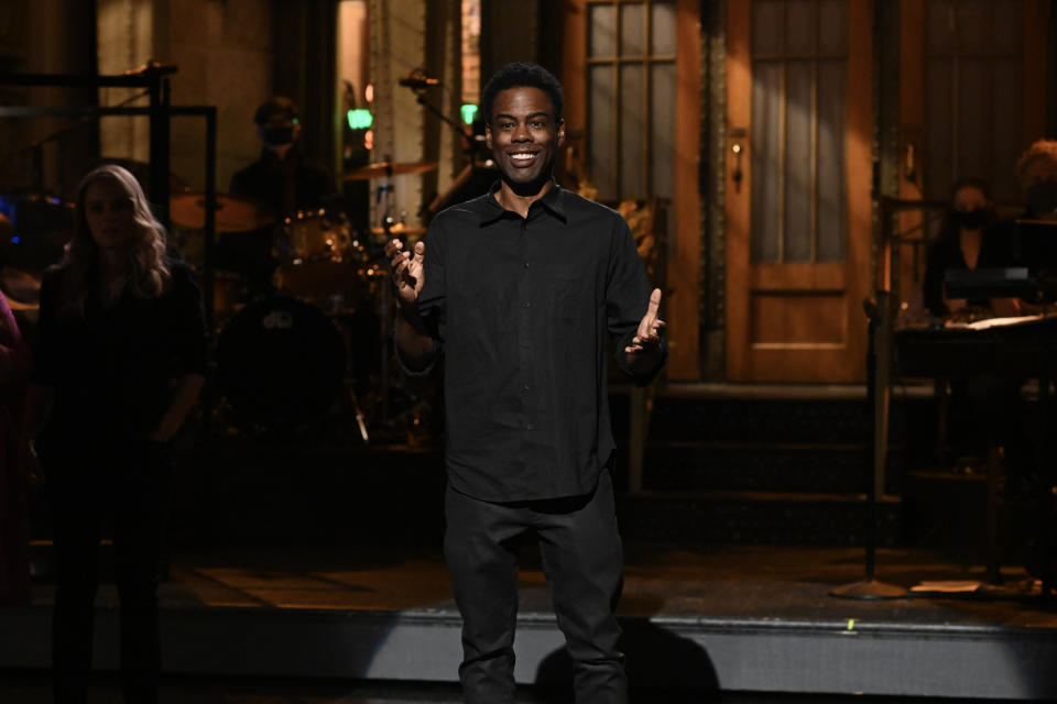 Chris Rock, appearing on Saturday Night Live in May, has COVID-19. (Photo: Will Heath/NBC/NBCU Photo Bank via Getty Images)