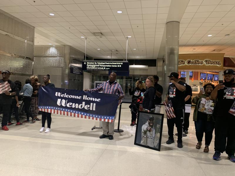 Family and friends await the arrival of Wendell Brown at the Detroit Metropolitan Wayne County Airport. (Dan Wetzel/Yahoo Sports)