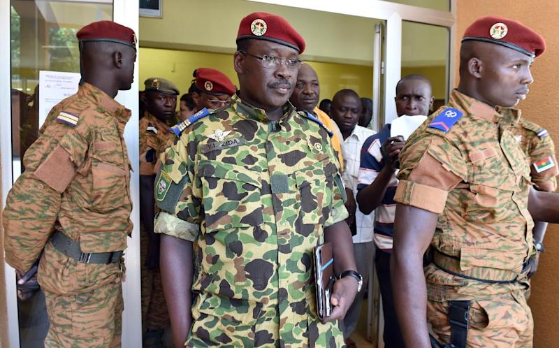 Burkina Faso Lieutenant-Colonel Yacouba Isaac Zida (C) leaves after a meeting with the country's military commanders in the capital Ouagadougou on November 1, 2014 (AFP Photo/Issouf Sanogo)