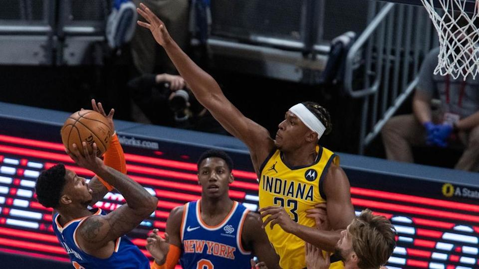 Jan 2, 2021; Indianapolis, Indiana, USA; New York Knicks guard Elfrid Payton (6) shoots the ball while Indiana Pacers center Myles Turner (33) defends in the first quarter at Bankers Life Fieldhouse. Mandatory Credit: Trevor Ruszkowski-USA TODAY Sports