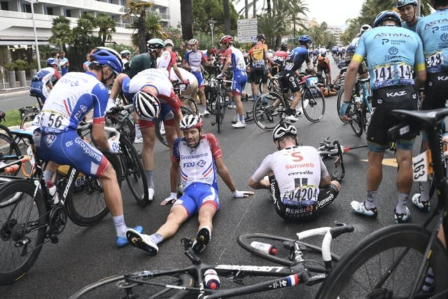 French rider Thibault Pinot (centre) was among those to fall