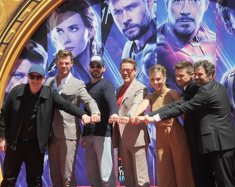 """HOLLYWOOD, CA - APRIL 23: Kevin Feige, Chris Hemsworth, Chris Evans, Scarlett Johansson, Mark Ruffalo and Jeremy Renner attend Marvel Studios' """"Avengers: Endgame"""" Cast Place Their Hand Prints In Cement At TCL Chinese Theatre IMAX Forecourt held at TCL Chinese Theatre IMAX on April 23, 2019 in Hollywood, California. (Photo by Albert L. Ortega/Getty Images)"""