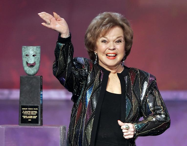 FILE - In this Jan. 29, 2006 file photo, Shirley Temple Black accepts the Screen Actors Guild Awards life achievement award at the 12th Annual Screen Actors Guild Awards, in Los Angeles. Shirley Temple, the curly-haired child star who put smiles on the faces of Depression-era moviegoers, has died. She was 85. (AP Photo/Mark J. Terrill, File)