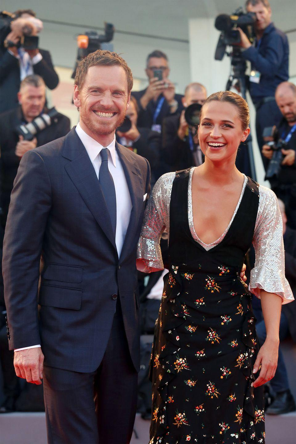 "<p>Alicia Vikander, 30, and husband Michael Fassbender, 41, started dating back in 2014 after meeting on the set of <em>The Light Between Oceans</em>. The lovebirds kept it low-key for the cameras at the beginning of their relationship, but were outed as a newlyweds after they returned from their <a href=""https://www.harpersbazaar.com/celebrity/latest/a13031336/alicia-vikander-michael-fassbender-married/"" rel=""nofollow noopener"" target=""_blank"" data-ylk=""slk:incognito wedding in Ibiza"" class=""link rapid-noclick-resp"">incognito wedding in Ibiza</a> in 2017.</p>"