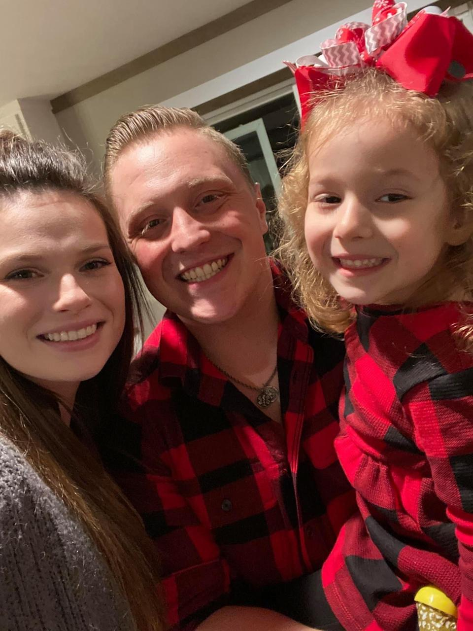 Lylah Baker and her parents, Josy and Dustin Baker, who have spent day and night with her at the hospital as she battles melioidosis.