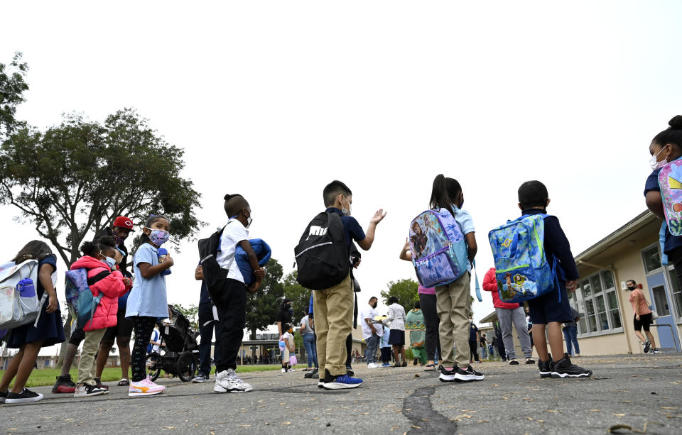 Kindergarten students line up for class at Webster Elementary School on the first day of the Fall semester for Long Beach Unified School District in Long Beach on Tuesday, August 31, 2021. (Brittany Murray/MediaNews Group/Long Beach Press-Telegram via Getty Images)